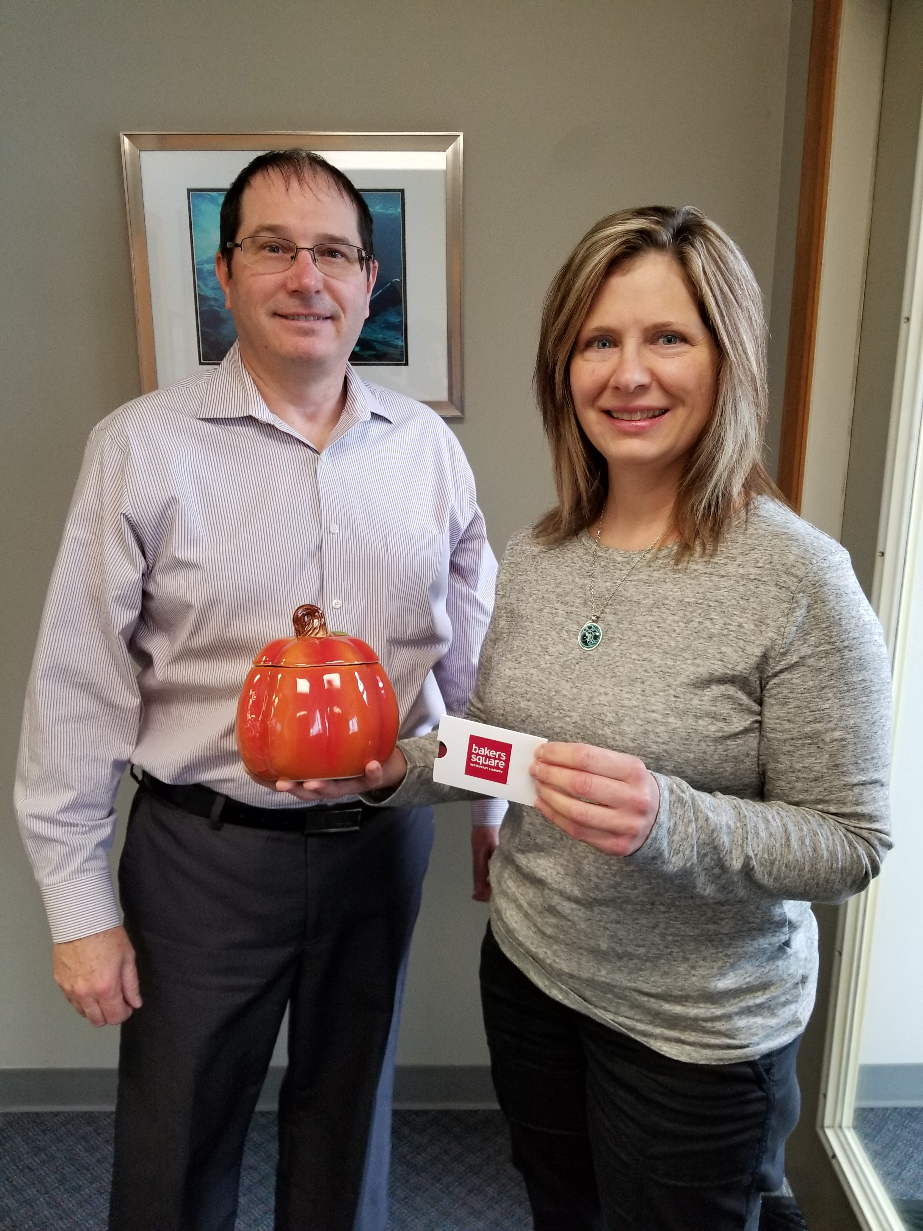 Picture of Dr. Michael Gordon and a patient after winning a contest in our Schereville dental office.